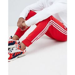3-stripe skinny joggers with cuffed hem in red dh5837 - red marki Adidas originals